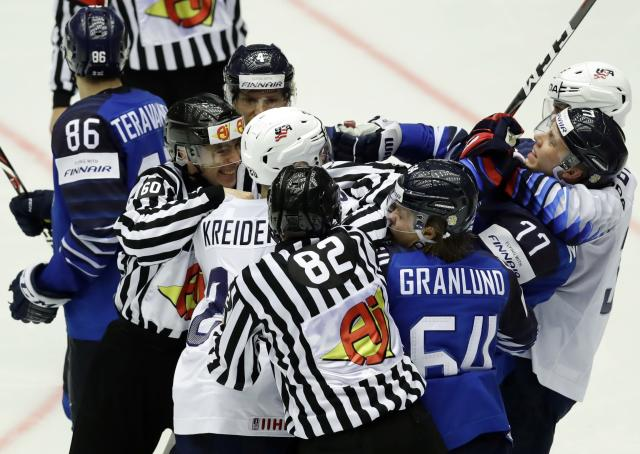 Ice Hockey - 2018 IIHF World Championships - Group B - Finland v USA - Jyske Bank Boxen - Herning, Denmark - May 15, 2018 - Referees try to separate players as they scuffle. REUTERS/David W Cerny