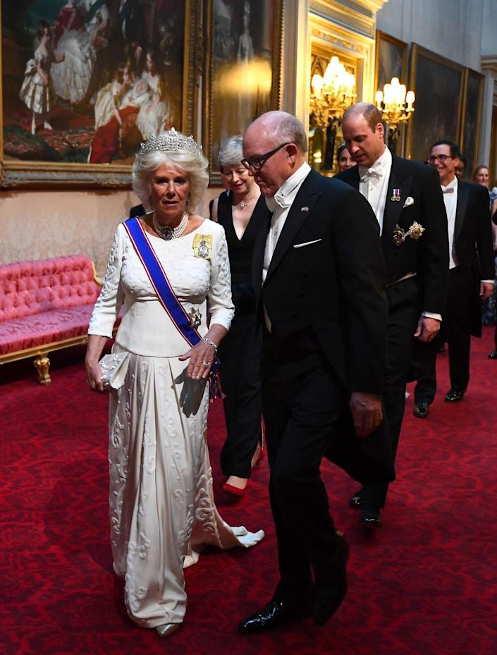 <p>For the banquet in honor of Trump's state visit to the U.K., the Duchess of Cornwall chose a cream embroidered evening gown by Bruce Oldfield. She paired the dress with the diamond boucheron tiara, a pearl and rose topaz choker, diamond earrings, and the Royal Victorian Order, and the Royal family Order. </p>