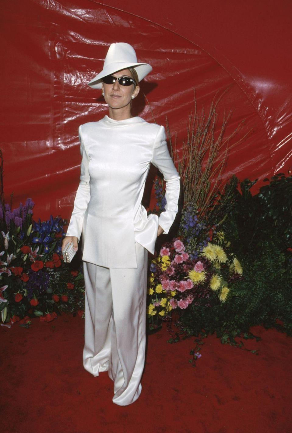 <p>Slated as one of her biggest fashion risks, this white suit certainly pushed boundaries. The oversized trousers contrast the adorably tiny clutch, and the matching hat completed the look.</p>
