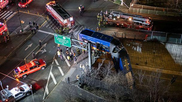 PHOTO: A bus that careened off a road in the Bronx neighborhood of New York City is seen left dangling from an overpass Friday, Jan. 15, 2021. (Craig Ruttle/AP)