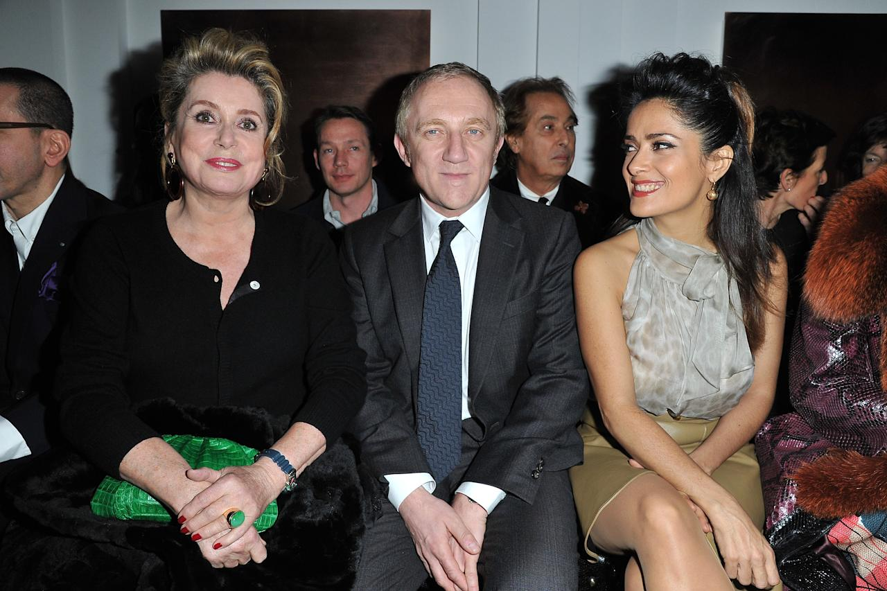 PARIS, FRANCE - MARCH 05:  Catherine Deneuve, Francois-Henri Pinault and Salma Hayek attend the Yves Saint-Laurent Ready-To-Wear Fall/Winter 2012 show as part of Paris Fashion Week on March 5, 2012 in Paris, France.  (Photo by Pascal Le Segretain/Getty Images)