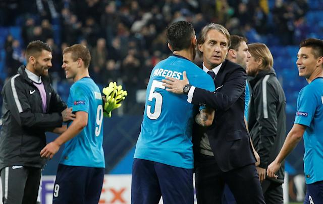 Soccer Football - Europa League Round of 32 Second Leg - Zenit Saint Petersburg vs Celtic - Stadium St. Petersburg, Saint Petersburg, Russia - February 22, 2018 Zenit St. Petersburg coach Roberto Mancini celebrates with Leandro Paredes after the match REUTERS/Anton Vaganov