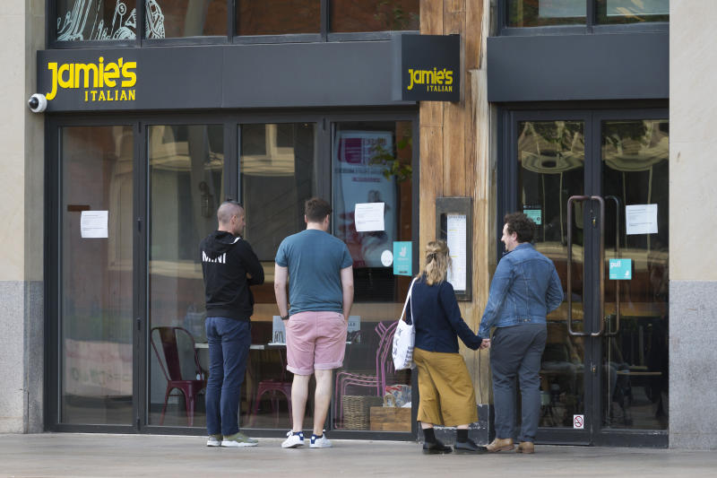CARDIFF, UNITED KINGDOM - MAY 21: People look into the window of a Jamies Italian restaurant on the Hayes on May 21, 2019 in Cardiff, United Kingdom. More than 1,000 jobs are at risk after the chain of restaurants belonging to celebrity chef Jamie Oliver has been placed into administration. Just under forty restaurants including the Jamies Italian, Fifteen and Barbecoa brand are now at risk of closure. The business had been seeking buyers due to stiff competition in the market. (Photo by Matthew Horwood/Getty Images)
