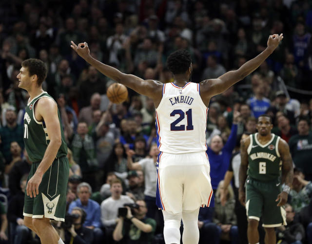 Philadelphia 76ers' Joel Embiid (21) reacts after making a shot during the second half of the team's NBA basketball game against the Milwaukee Bucks on Sunday, March 17, 2019, in Milwaukee. The 76ers won 130-125. (AP Photo/Aaron Gash)