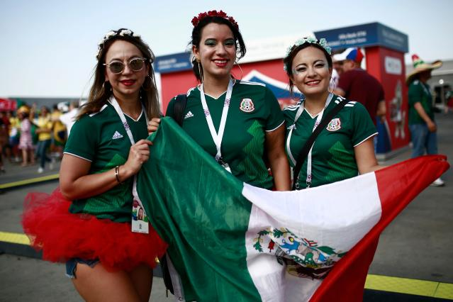 <p>Mexico fans pose before the Russia 2018 World Cup round of 16 football match between Brazil and Mexico at the Samara Arena in Samara on July 2, 2018. (Photo by Benjamin CREMEL / AFP) </p>
