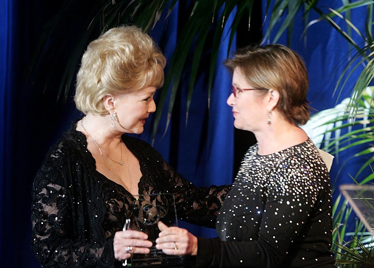 Carrie Fisher gives the Lacoste Presidents Award to her mother at the 2005 Costume Designers Guild Awards at the Beverly Hilton Hotel in Beverly Hills.