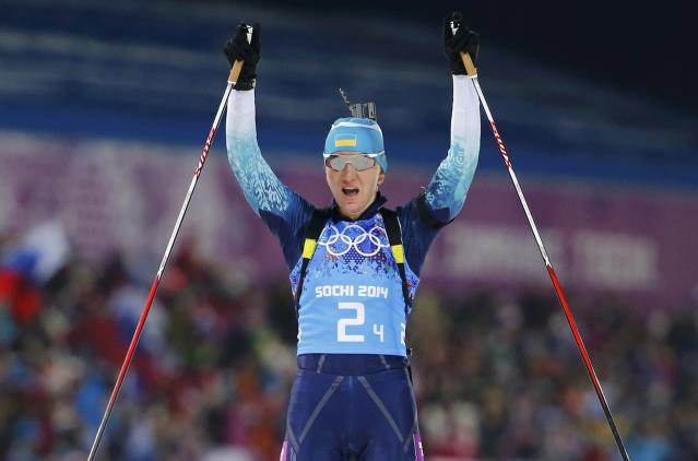 Ukraine's Olena Pidhrushna celebrates as she crosses the finish line to win the women's biathlon 4x6 km relay event at the Sochi 2014 Winter Olympic Games February 21, 2014. REUTERS/Carlos Barria (RUSSIA - Tags: OLYMPICS SPORT BIATHLON)