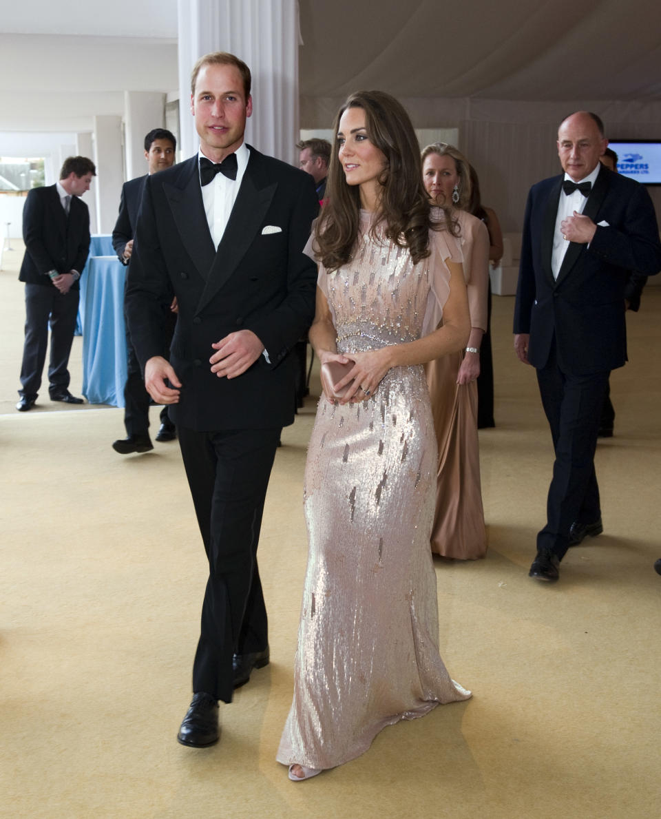 The Duke and Duchess of Cambridge, Prince William and Catherine, attend the 10th Annual Absolute Return for Kids (ARK) Gala Dinner on behalf of the Foundation of Prince William and Prince Harry, at Perks Field, Kensington Palace, in London, on June 9, 2011. AFP PHOTO / POOL / Arthur Edwards (Photo credit should read ARTHUR EDWARDS/AFP via Getty Images)
