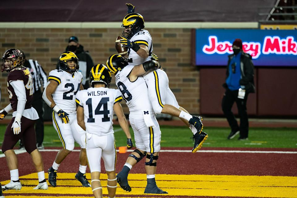 Michigan fullback Ben Mason celebrates with Andrew Vastardis after scoring a touchdown against the Minnesota Golden Gophers in the first quarter of the game at TCF Bank Stadium on Oct. 24, 2020 in Minneapolis, Minnesota.
