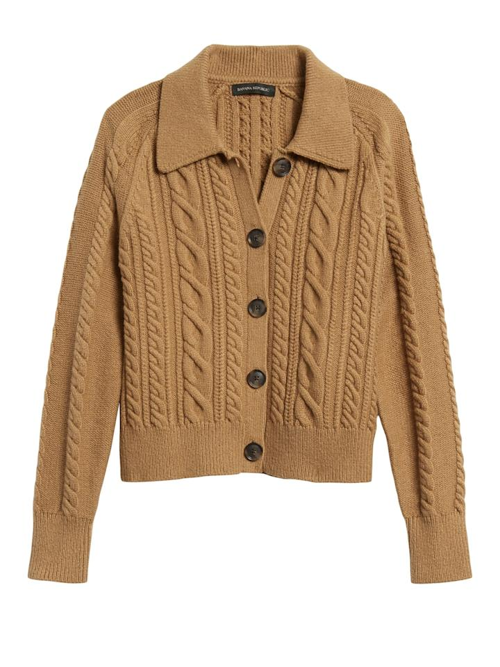 """<p>Swap your blazer for this cozy <product href=""""https://bananarepublic.gap.com/browse/product.do?pid=615836002&amp;cid=5032&amp;pcid=5032&amp;vid=1&amp;nav=meganav%3AWomen%3AWomen%27s%20Apparel%3ASweaters&amp;grid=pds_224_257_1#pdp-page-content"""" target=""""_blank"""" class=""""ga-track"""" data-ga-category=""""internal click"""" data-ga-label=""""https://bananarepublic.gap.com/browse/product.do?pid=615836002&amp;cid=5032&amp;pcid=5032&amp;vid=1&amp;nav=meganav%3AWomen%3AWomen%27s%20Apparel%3ASweaters&amp;grid=pds_224_257_1#pdp-page-content"""" data-ga-action=""""body text link"""">Banana Republic Heritage Cable-Knit Cardigan Sweater</product> ($103, originally $129).</p>"""