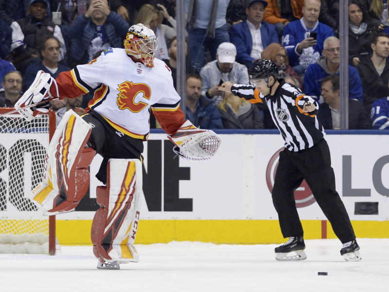 Calgary Flames goaltender David Rittich (33) reacts after making a save against the Toronto Maple Leafs in the shootout of an NHL hockey game Thursday, Jan. 16, 2020, in Toronto. (Nathan Denette/The Canadian Press via AP)