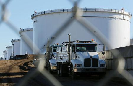 FILE PHOTO --  Dump trucks are parked near crude oil tanks at Kinder Morgan's North 40 terminal expansion construction project in Sherwood Park