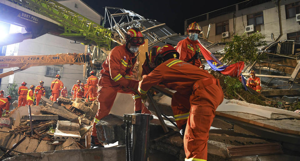 Rescuers prepare equipment as they search for survivors at a collapsed hotel in Suzhou in eastern China's Jiangsu Province. Source: AP