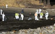 Cleanup crews remove oil-laden sand on the beach on Wednesday at Refugio State Beach, the site of an oil spill, north of Goleta, Calif. A broken, onshore pipeline spewed oil down a storm drain and into the ocean for several hours Tuesday before it was shut off, creating a slick some 4 miles long about 20 miles west of Santa Barbara. (Michael A. Mariant/AP)