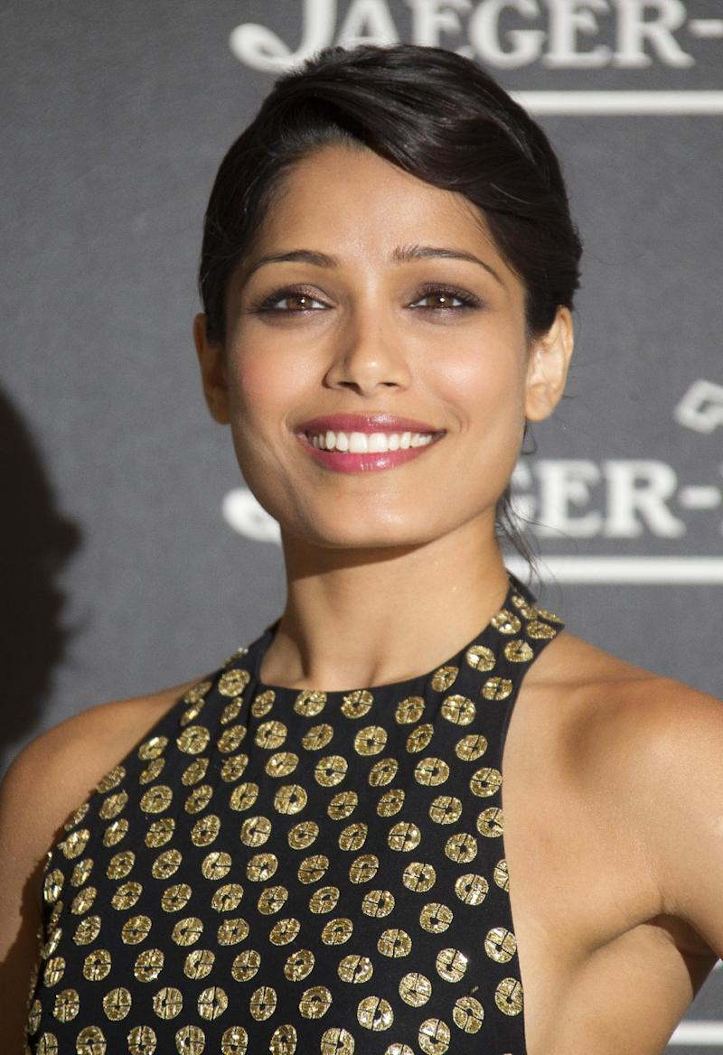 """FILE - In a Tuesday, Sept. 4, 2012 file photo, actress Freida Pinto arrives for a party in Venice, Italy. Pinto introduced """"Girl Rising"""", Richard Robbins' new movie, Monday, Jan. 21, 2013 at Sundance Film Festival by sharing some powerful statistics: There are 66 million girls who are not in school; 14 million girls under 18 who will be married this year; and 150 million girls are victims of sexual violence each year.  (AP Photo/Joel Ryan, File)"""