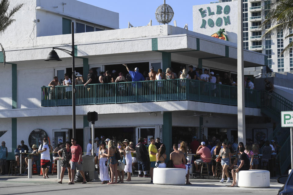 A general view of people partying on Fort Lauderdale Beach as Spring break crowds draw a concern during critical moment in the COVID-19 pandemic on March 14, 2021 in Fort Lauderdale, Florida. (mpi04/MediaPunch /IPX via AP)