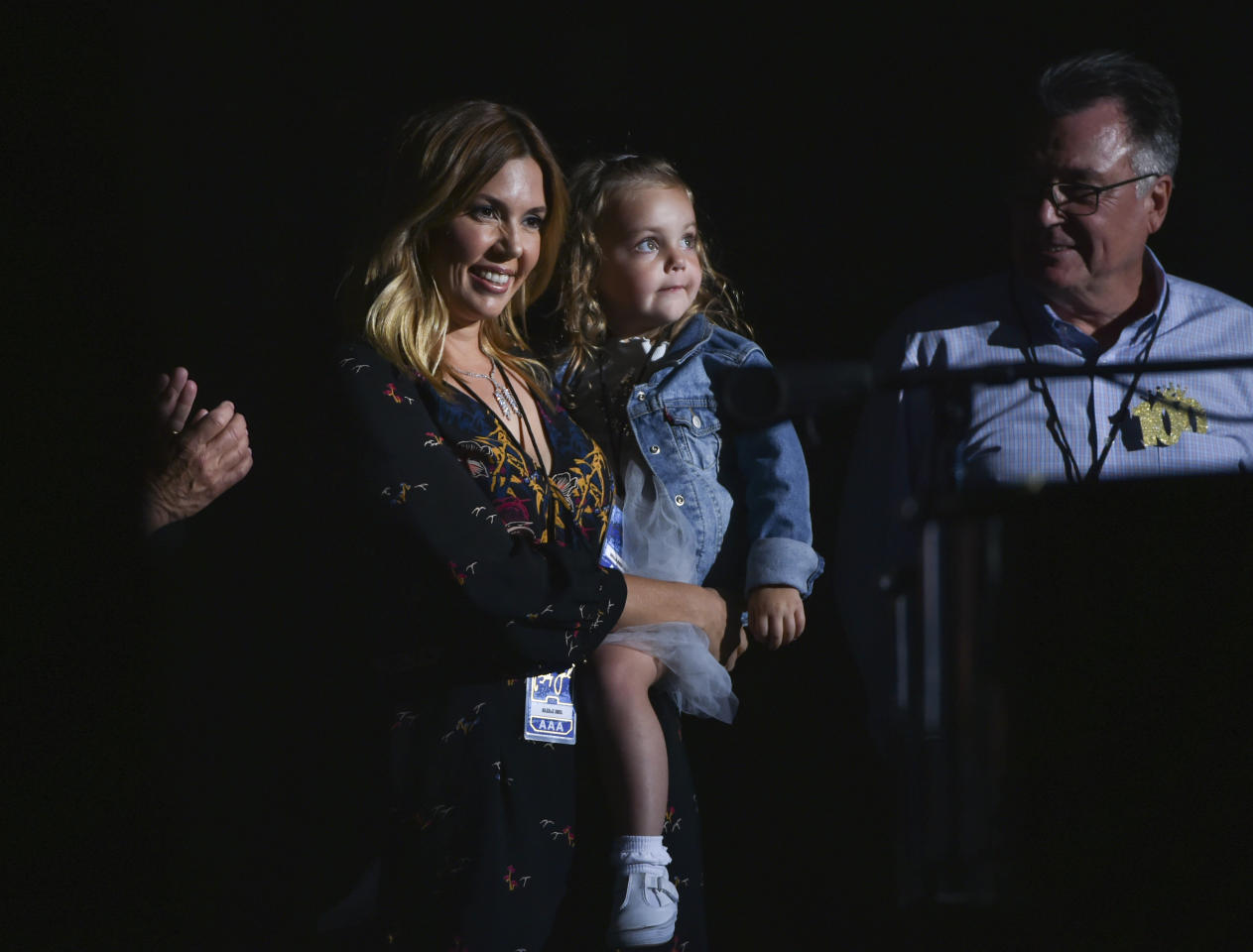 Musician Billy Joel's wife Alexis Roderick and his daughter Della Rose Joel smile on stage during his 100th lifetime performance at Madison Square Garden on Wednesday, July 18, 2018, in New York. (Photo by Evan Agostini/Invision/AP)