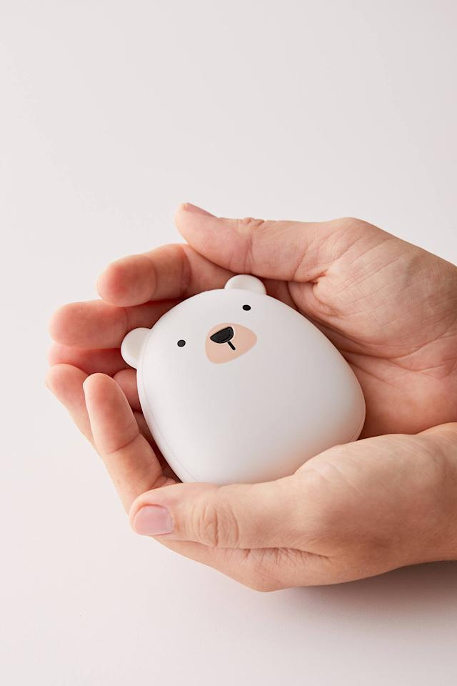 """<p>They can stay warm and toasty with this <a href=""""https://www.popsugar.com/buy/Polar-Bear-USB-Hand-Warmer-512307?p_name=Polar%20Bear%20USB%20Hand%20Warmer&retailer=urbanoutfitters.com&pid=512307&price=30&evar1=savvy%3Auk&evar9=36084638&evar98=https%3A%2F%2Fwww.popsugar.com%2Fsmart-living%2Fphoto-gallery%2F36084638%2Fimage%2F46986030%2FPolar-Bear-USB-Hand-Warmer&list1=gifts%2Choliday%2Cgift%20guide%2Choliday%20living%2Ctweens%20and%20teens%2Cgifts%20under%20%2450%2Cgifts%20for%20teens%2Cunder%20%24100&prop13=api&pdata=1"""" rel=""""nofollow"""" data-shoppable-link=""""1"""" target=""""_blank"""" class=""""ga-track"""" data-ga-category=""""Related"""" data-ga-label=""""https://www.urbanoutfitters.com/shop/polar-bear-usb-hand-warmer?category=stocking-stuffers&amp;color=010&amp;type=REGULAR"""" data-ga-action=""""In-Line Links"""">Polar Bear USB Hand Warmer</a> ($30).</p>"""