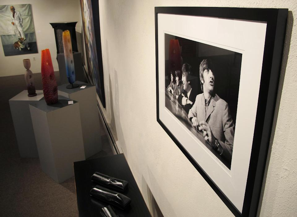 This July 27, 2013 image shows a photograph of the Beatles taken in 1964 by photographer Mike Mitchell on exhibit at the David Anthony Fine Art gallery in Taos, N.M. Mitchell's portraits of the Beatles are the centerpiece of a monthlong photography exhibition at the gallery. This marks the first time the portraits have been exhibited since their 2011 unveiling at a Christie's auction in New York City. (AP Photo/Susan Montoya Bryan)