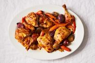 """Cooking chicken in a lidded pot over low heat lets the bird gently steam, resulting in meat that's juicier than if you roasted it uncovered. Get through that haggadah first—when you're ready to eat, crank up the oven to crisp up the skin. <a href=""""https://www.epicurious.com/recipes/food/views/slow-roasted-chicken-with-honey-glazed-carrots-and-ginger?mbid=synd_yahoo_rss"""" rel=""""nofollow noopener"""" target=""""_blank"""" data-ylk=""""slk:See recipe."""" class=""""link rapid-noclick-resp"""">See recipe.</a>"""