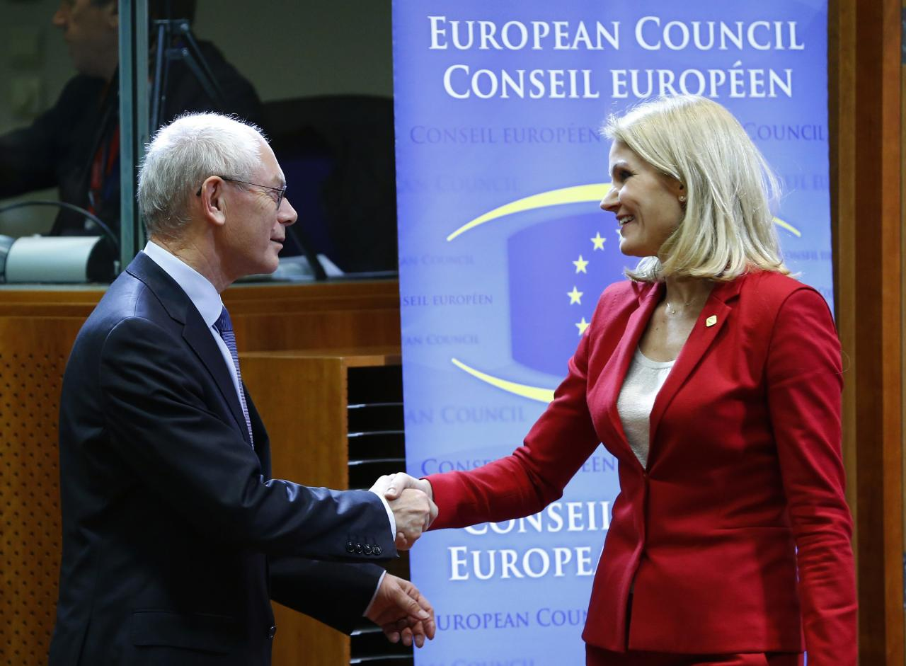 Denmark's Prime Minister Helle Thorning Schmidt (R) is welcomed by European Council President Herman Van Rompuy (L) at a European Union leaders summit in Brussels October 24, 2013. German and French accusations that the United States has run spying operations in their countries, including possibly bugging Chancellor Angela Merkel's mobile phone, are likely to dominate a meeting of EU leaders starting on Thursday. The two-day Brussels summit, called to tackle a range of social and economic issues, will now be overshadowed by debate on how to respond to the alleged espionage by Washington against two of its closest European Union allies. REUTERS/Yves Herman (BELGIUM - Tags: POLITICS)
