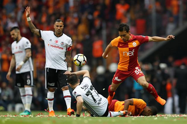 Soccer Football - Turkish Super League - Galatasaray v Besiktas - Turk Telekom Arena, Istanbul, Turkey - April 29, 2018 Galatasaray's Yuto Nagatomo in action with Besiktas' Gokhan Gonul REUTERS/Murad Sezer