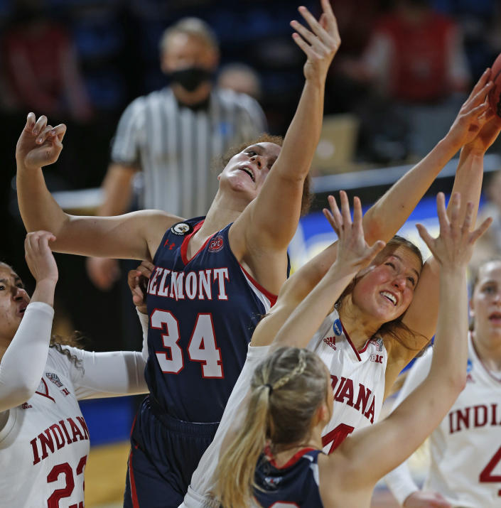 Belmont forward Cam Browning (34) fights Indiana guard Ali Patberg (14) for a rebound during the first half of a college basketball game in the second round of the NCAA women's tournament at Greehey Arena in San Antonio on Wednesday, March 24, 2021. (AP Photo/Ronald Cortes)