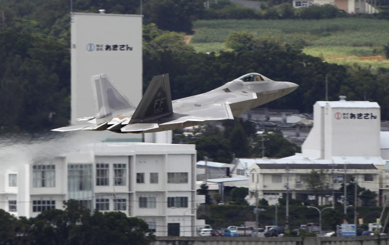 In this Aug. 14, 2012 photo, a U.S. Air Force F-22 Raptor takes off from Kadena Air Base on the southern island of Okinawa, in Japan. The deployment of a dozen F-22 stealth fighters to Japan has so far gone off without a hitch as the aircraft are being brought back into the skies in their first overseas mission since restrictions were imposed over incidents involving pilots getting dizzy and disoriented, a senior U.S. Air Force commander told the Associated Press on Thursday, Aug. 30, 2012. (AP Photo/Greg Baker)