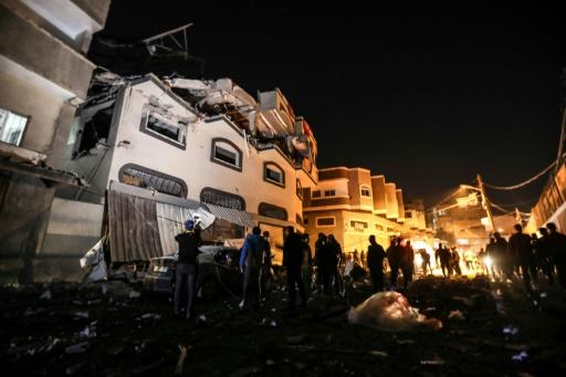 Palestinians inspect the damaged house of Islamic Jihad leader Baha Abu Al-Ata after the deadly attack