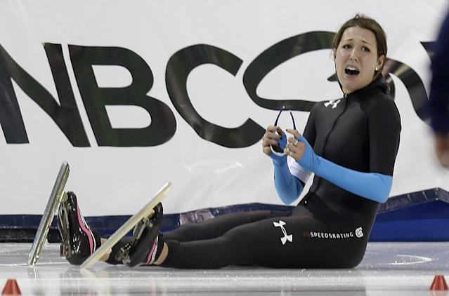 Petra Acker looks up after crashing after finishing the women's 3,000-meter during the U.S. Olympic speedskating trials Friday, Dec. 27, 2013, in Kearns, Utah. Acker came in fourth place. (AP Photo/Rick Bowmer)