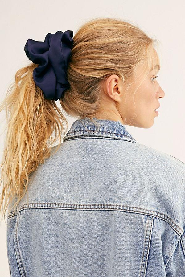 """<p>For the person who's never without a scrunchie, gift them this <a href=""""https://www.popsugar.com/buy/Free-People-Super-Scrunchie-522556?p_name=Free%20People%20Super%20Scrunchie&retailer=freepeople.com&pid=522556&price=12&evar1=tres%3Aus&evar9=45496944&evar98=https%3A%2F%2Fwww.popsugar.com%2Flove%2Fphoto-gallery%2F45496944%2Fimage%2F46937394%2FFree-People-Super-Scrunchie&list1=shopping%2Cgifts%2Choliday%2Cstocking%20stuffers%2Cgift%20guide%2Cgifts%20for%20women%2Cgifts%20for%20men%2Cgifts%20under%20%24100%2Cgifts%20for%20teens&prop13=api&pdata=1"""" rel=""""nofollow"""" data-shoppable-link=""""1"""" target=""""_blank"""" class=""""ga-track"""" data-ga-category=""""Related"""" data-ga-label=""""https://www.freepeople.com/shop/super-scrunchie/?category=gifts-stocking-stuffers&amp;color=044"""" data-ga-action=""""In-Line Links"""">Free People Super Scrunchie</a> ($12).</p>"""