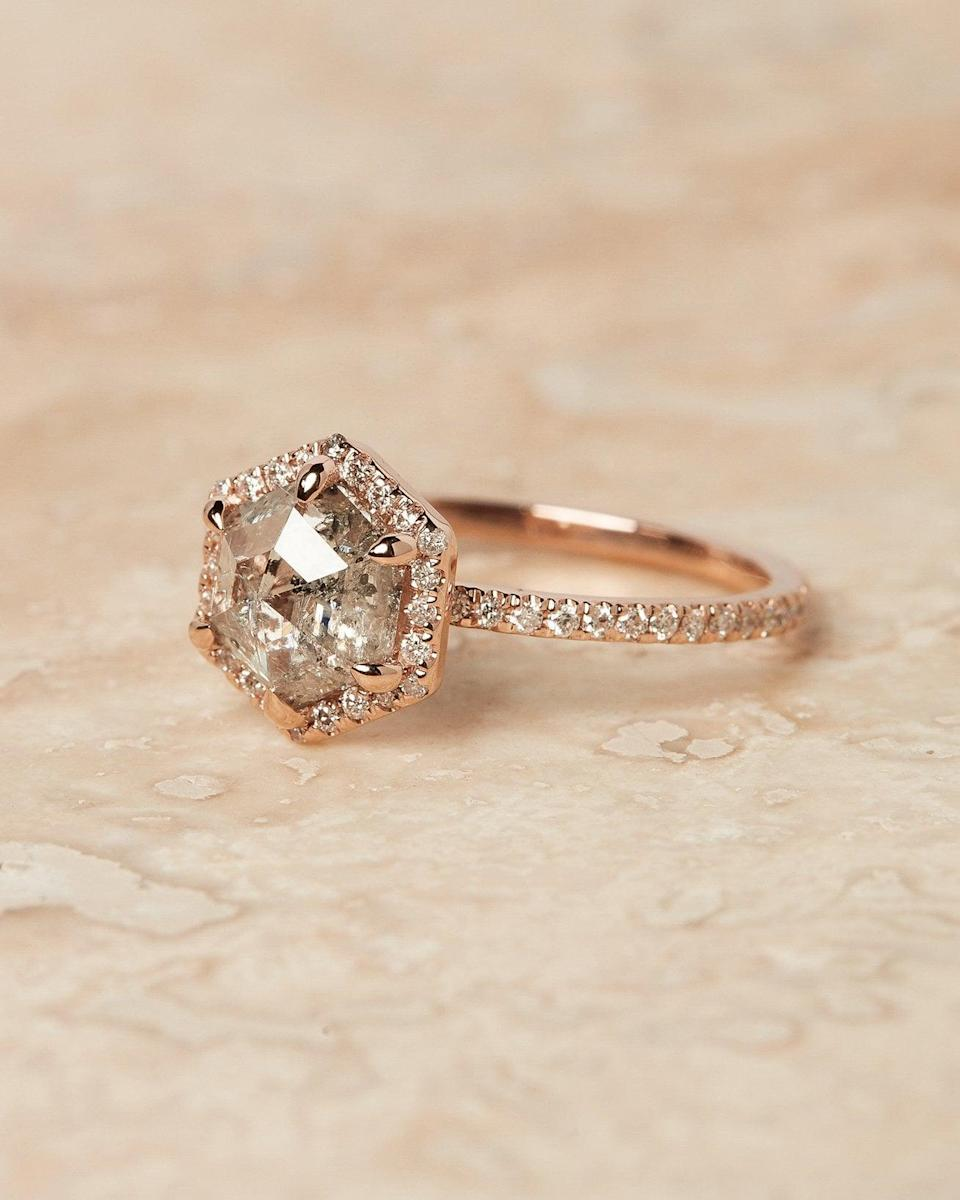 """<p>The chic rose gold pavè band that surrounds the salt and pepper diamond on the <a href=""""https://www.popsugar.com/buy/Apr%C3%A8s-Jewelry-Valentina-Ring-Setting-533295?p_name=Apr%C3%A8s%20Jewelry%20the%20Valentina%20Ring%20Setting&retailer=apresjewelry.com&pid=533295&price=2%2C190&evar1=fab%3Aus&evar9=47015200&evar98=https%3A%2F%2Fwww.popsugar.com%2Ffashion%2Fphoto-gallery%2F47015200%2Fimage%2F47016162%2FHexagons-Apr%C3%A8s-Jewelry-Valentina-Ring-Setting&list1=shopping%2Cjewelry%2Crings%2Cengagement%20rings&prop13=mobile&pdata=1"""" rel=""""nofollow noopener"""" class=""""link rapid-noclick-resp"""" target=""""_blank"""" data-ylk=""""slk:Après Jewelry the Valentina Ring Setting"""">Après Jewelry the Valentina Ring Setting</a> ($2,190, setting only) gives this ring extra sparkle.</p>"""