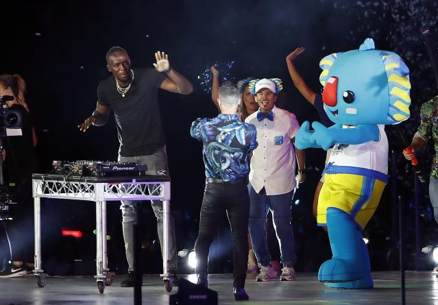 Gold Coast 2018 Commonwealth Games - Closing Ceremony - Carrara Stadium - Gold Coast, Australia - April 15, 2018. Former Jamaican sprinter Usain Bolt plays the DJ desks during the closing ceremony. REUTERS/Paul Childs