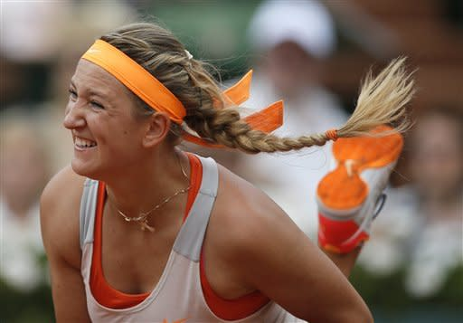 Belarus' Victoria Azarenka serves to Russia's Maria Sharapova during their semifinal match of the French Open tennis tournament at the Roland Garros stadium Thursday, June 6, 2013 in Paris. (AP Photo/Petr David Josek)