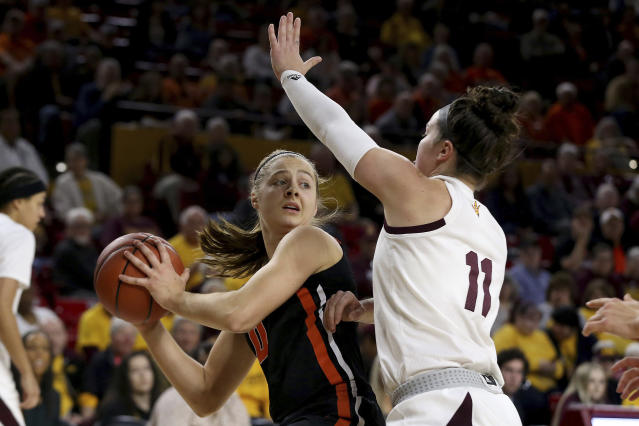 Oregon State's Mikayla Pivec (0) looks to pass against Arizona State's Robbi Ryan (11) during the first half of an NCAA college basketball game Sunday, Jan. 12, 2020, in Tempe, Ariz. (AP Photo/Darryl Webb)