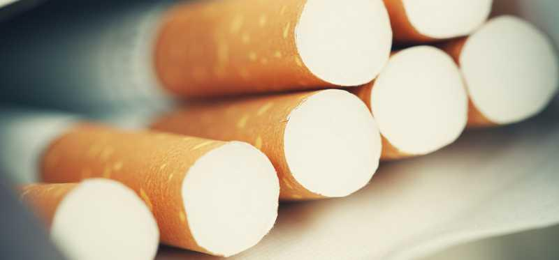 Close up of an open pack of cigarettes.