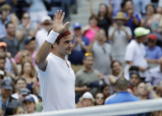 Roger Federer, of Switzerland, waves after defeating Benoit Paire, of France, during the second round of the U.S. Open tennis tournament, Thursday, Aug. 30, 2018, in New York. (AP Photo/Kevin Hagen)