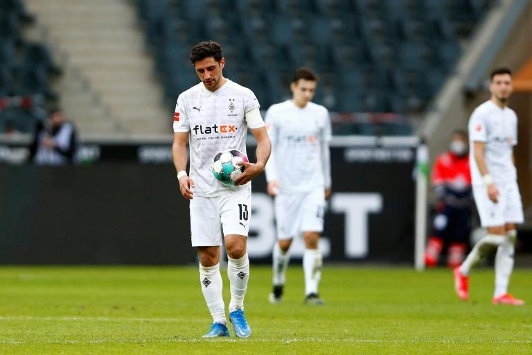 Moenchengladbach captain Lars Stindl trudges off after Saturday's shock defeat to Mainz