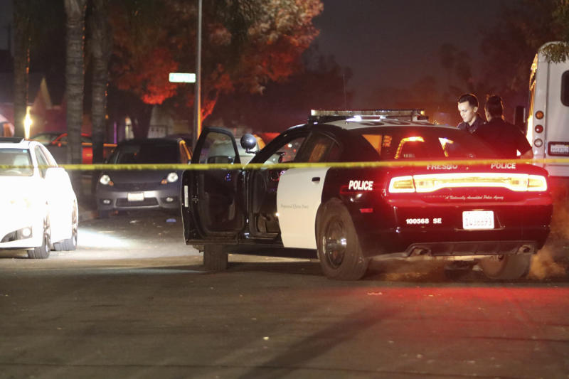 Police work at the scene of a shooting, Sunday, Nov. 17, 2019, in southeast Fresno, Calif. (Photo: Larry Valenzuela/The Fresno Bee via AP)