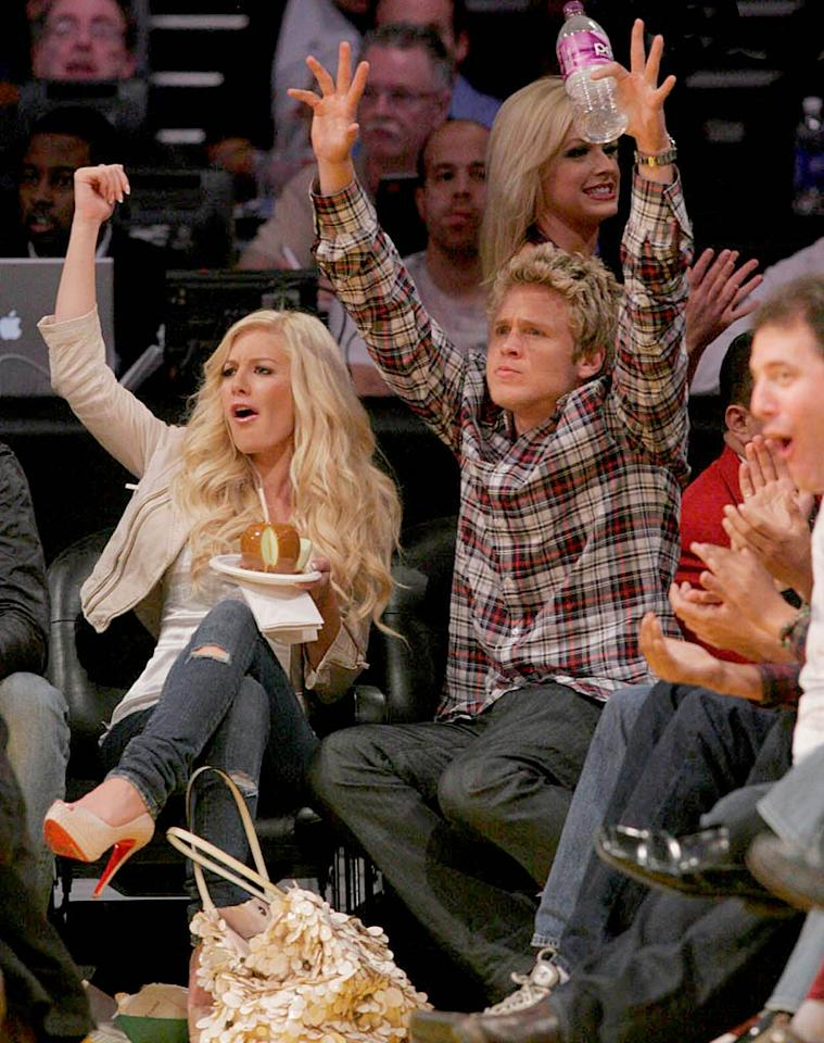 "Heidi Montag and Spencer Pratt take a break from snacking on a caramel apple to throw their hands in the air in support of the hometown team. <a href=""http://www.splashnewsonline.com/"" target=""new"">Splash News</a> - March 29, 2009"