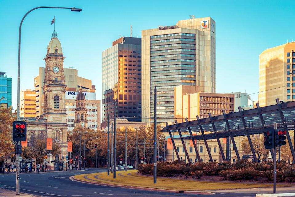 Adelaide, Australia - April 22, 2019: Colonial and modern buildings viewed across Victoria Square at sunset time