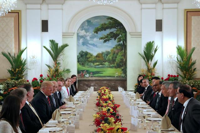<p>U.S. President Donald Trump and his delegation have lunch with Singapore's Prime Minister Lee Hsien Loong and officials at the Istana in Singapore June 11, 2018. (PHOTO: Reuters) </p>