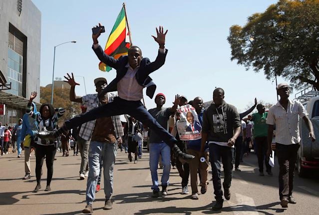 <p>Supporters of the opposition Movement for Democratic Change (MDC) party of Nelson Chamisa, sing and dance as they march in the streets of Harare, Zimbabwe, August 1, 2018. (Photo: Siphiwe Sibeko/Reuters) </p>
