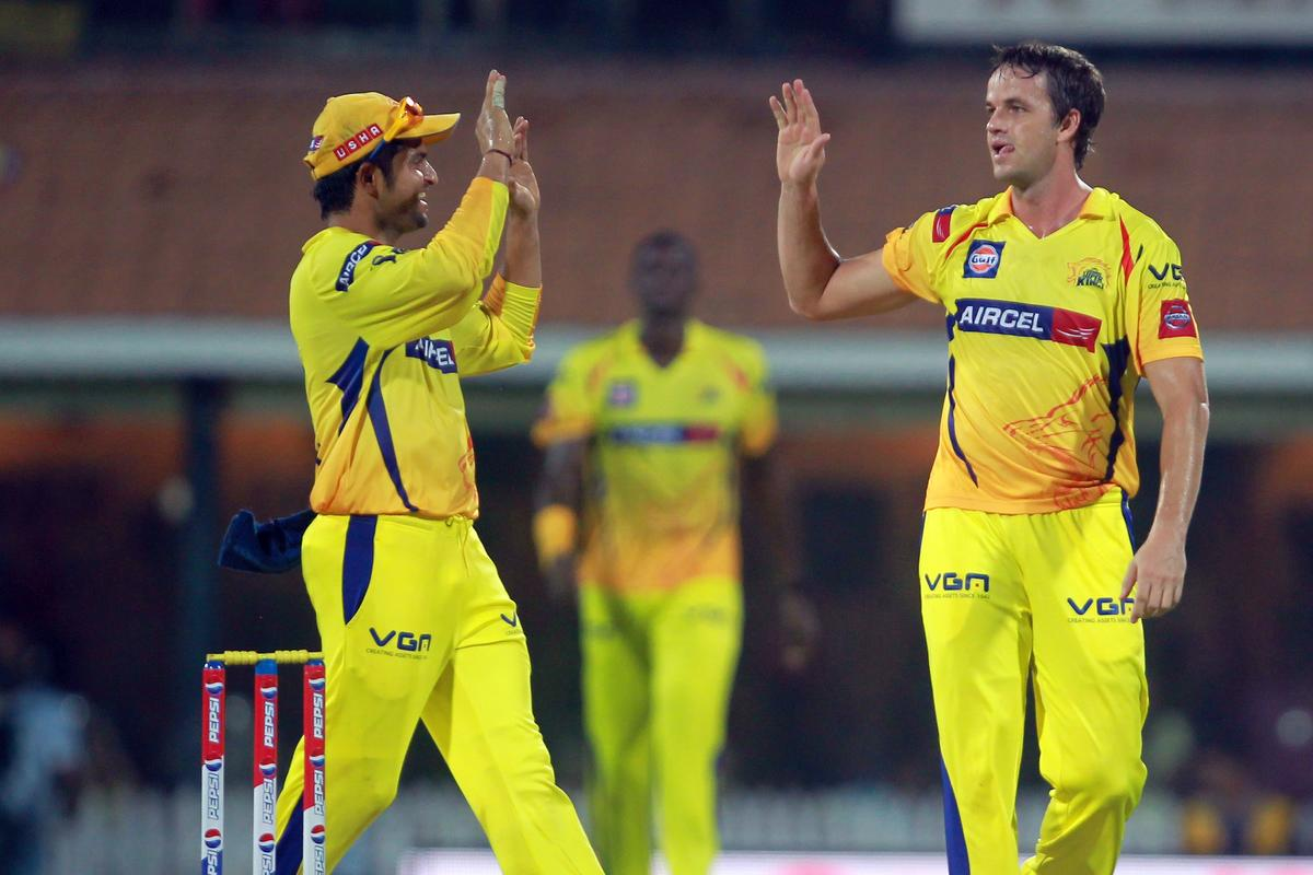 Albie Morkel is congratulated by Suresh Raina on taking the wicket of Kedar Jadhav during match 64 of the Pepsi Indian Premier League between the Chennai Super Kings and the Delhi Daredevils held at the MA Chidambaram Stadium in Chennai on the 14th May 2013. Photo by Jacques Rossouw-IPL-SPORTZPICS . .Use of this image is subject to the terms and conditions as outlined by the BCCI. These terms can be found by following this link:..https://ec.yimg.com/ec?url=http%3a%2f%2fwww.sportzpics.co.za%2fimage%2fI0000SoRagM2cIEc&t=1493291187&sig=yYPlMmMARZsW07r5.1HVNA--~C
