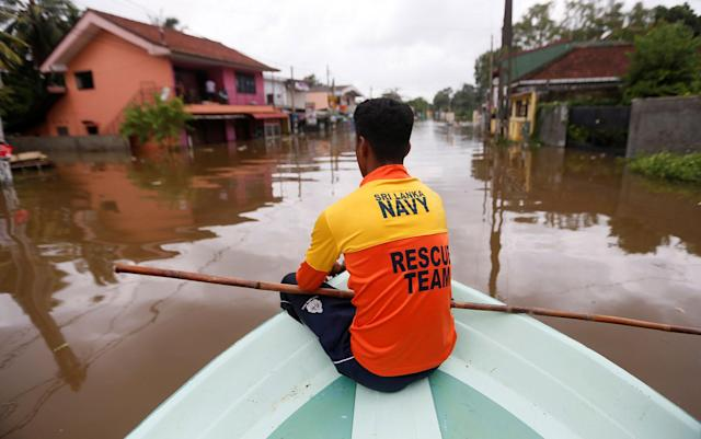 <p>A Sri Lankan Navy rescue team member searches for flood victims on a flooded road in Nagoda village in Kalutara, Sri Lanka, May 29, 2017. (Dinuka Liyanawatte/Reuters) </p>