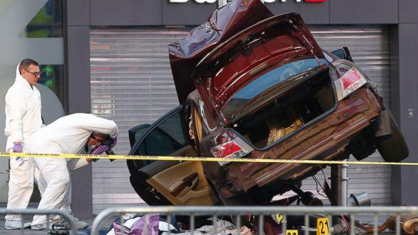 PHOTO:Investigators photograph evidence at the scene of a crash that killed one person and injured almost two dozen others in Times Square, May 18, 2017, in New York. (Kathy Willens/AP Photo)