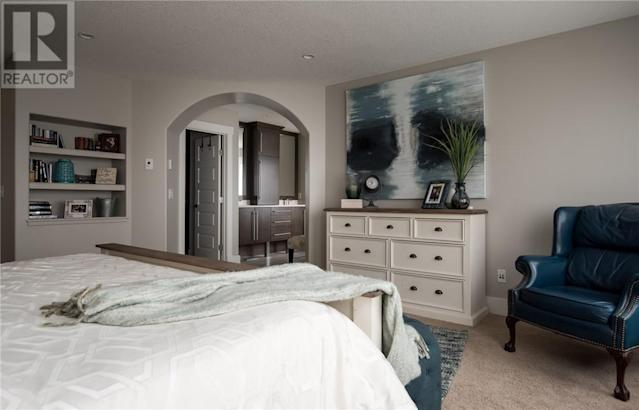 <p><span>209 Trillium Rd., Fort McMurray, Alta.</span><br> There are four bedrooms in the home, including this master bedroom with a walk-in closet.<br> (Photo: Zoocasa) </p>