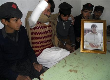 Hussan, brother of Hassan who was killed in a suicide bomb attack, sits with students of high school in a classroom at Government High School Ibrahim Zai in Hangu district, bordering North Waziristan