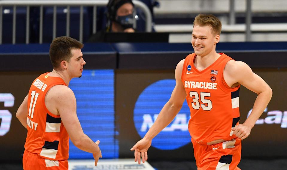 Syracuse Orange guard Buddy Boeheim (35) celebrates with guard Joseph Girard III (11) against the San Diego State Aztecs during the first round of the 2021 NCAA Tournament at Hinkle Fieldhouse.