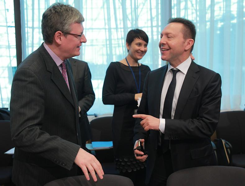 Greek Finance Minister Yannis Stournaras, right, talks with European Commissioner for Employment, Social Affairs and Inclusion Laszlo Andor, during the macro economic dialogue meeting at the European Council building in Brussels, Monday, March 10, 2014. (AP Photo/Yves Logghe)